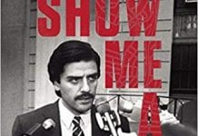 """A dark-haired man with a mustache wearing a suit stands with multiple reporters sticking microphones in his face. Over the black and white photo are large red block letters saying """"Show Me a Hero."""" Smaller type gives author Lisa Belkin and notes the book is now an HBO show."""