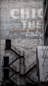 block clubs: photo shows a Chicago building with painted lettering