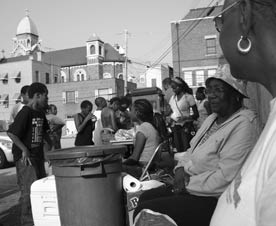 A black-and-white photo shows a community celebration, to illustrate an article about eminent domain reform.