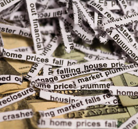 image shows shreds of newsprint with text announcing falling home prices, to illustrate an article about national housing policy
