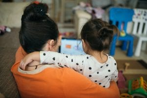 Back view of a mother and daughter looking at a laptop, illustrating an article about HAMP, or the Home Affordable Modification Program