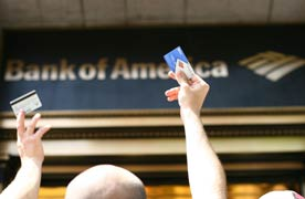 Bank of America sign, accompanying article about two banks