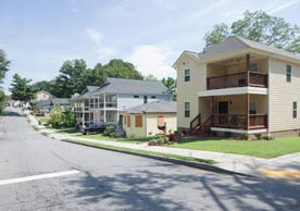 Photo shows a street with houses, accompanying an article about the Pittsburgh neighborhood of Atlanta