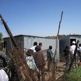 the right to housing: image shows shacks in Soweto