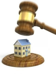 foreclosure and hospitalization. Illustration shows gavel coming down upon a small house