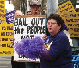Move our Money: Image shows a woman at an Occupy protest