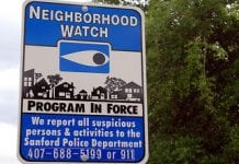 a street sign saying a neighborhood watch program is in force