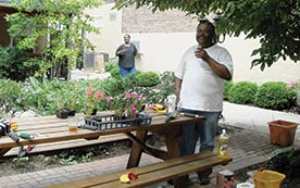 community land trusts and renters. Image shows man at picnic table