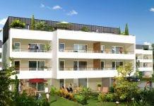 A white three-level building.