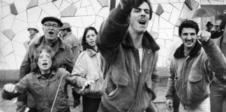 A black and white photo of Whitman, Philadelphia, residents shout and point to anti-housing demonstrators.