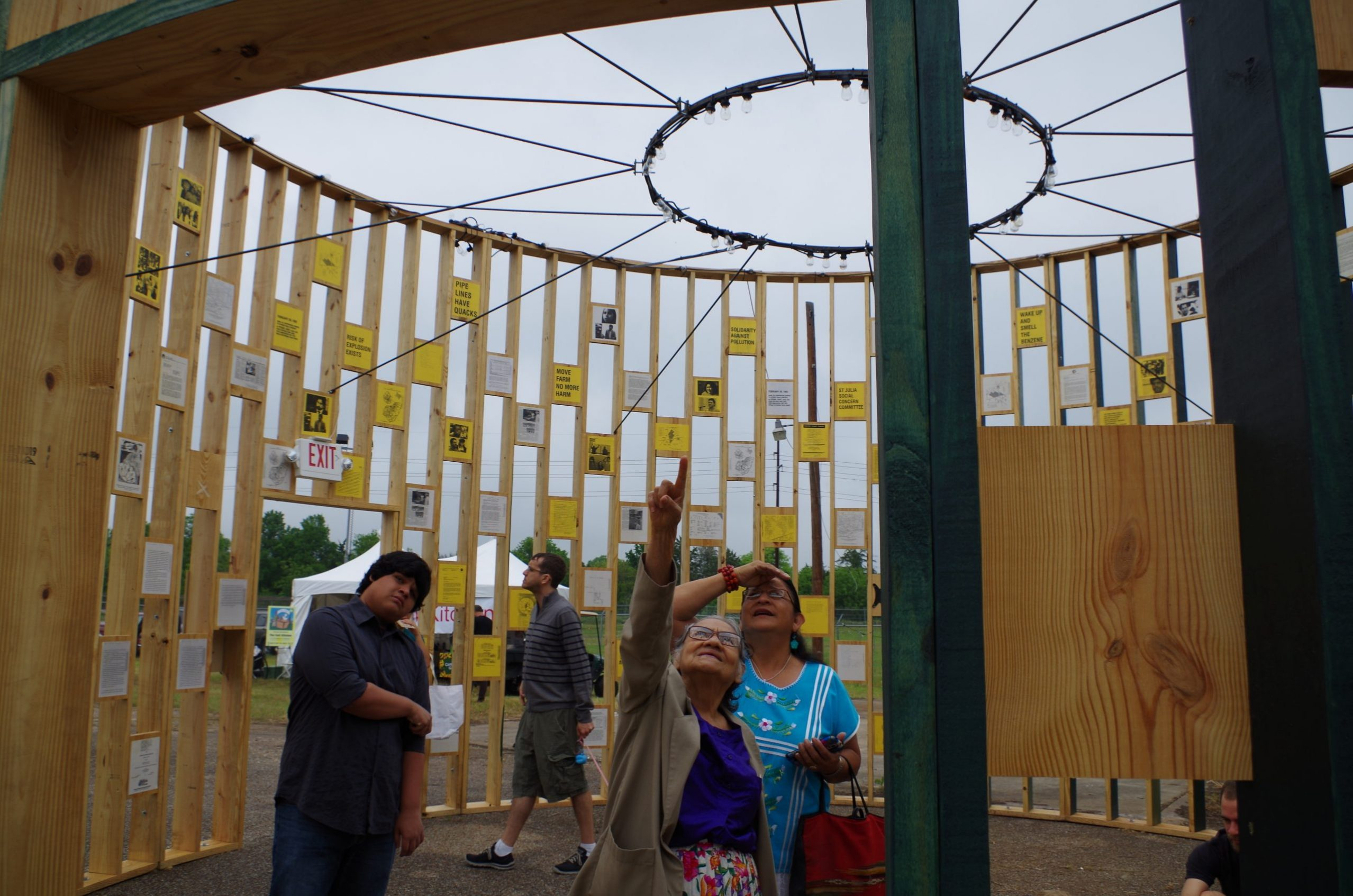 Locals view an art installation in Austin.
