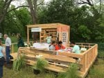 Residents in Austin, Texas, sit in a micro-unit home.