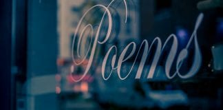 """A window sign that reads """"poems."""""""