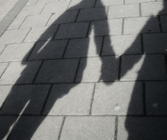 Shadow of two people holding hands, representing solidarity