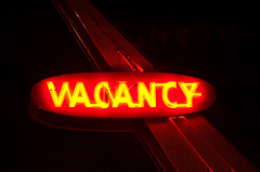 "a lit-up ""vacancy"" sign"