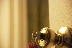 closeup image of key in doorknob