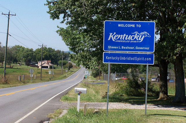 """A """"welcome to Kentucky"""" road sign"""