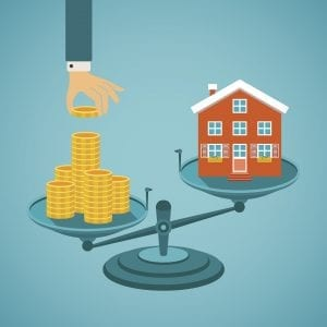 A concept piece of scales, on on side, a hand is shown placing money, on the other side, a home raises.