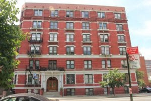 This brick, 34-unit building in Harlem, New York, is a limited-equity cooperative.