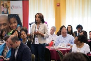 A woman who attended the 2016 National Housing Conference's event in New York City speak at the microphone.