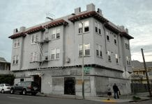 A grey-colored apartment building in Oakland California.
