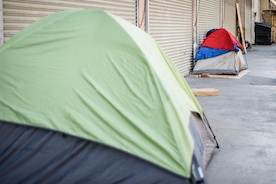 Tents for homeless people line a Skid Row street in Los Angeles in 2015.