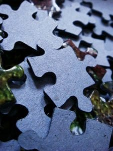 Up-close pieces of the unprinted sides of a puzzle.