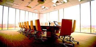 Chairs around a board room table