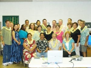 HACBED staff with the organization's founders.