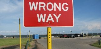 """Red road sign that says """"Wrong Way"""""""