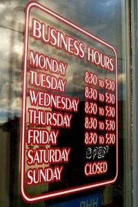 Business Hours sign on glass door.