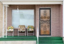 Front porch with three chairs.