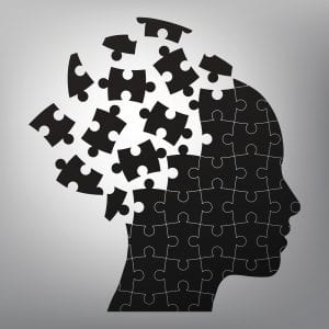 A black and white illustration of a head broken into puzzle pieces, which represents the need to look within oneself to understand whether implicit bias is at play.