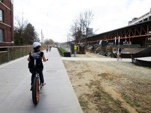 A bicyclist and pedestrians on Atlanta's BeltLine.