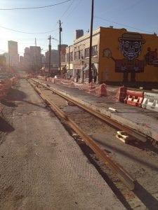 Afternoon light shines on street under construction for BeltLine streetcar.