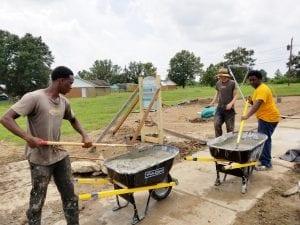 3 men mixing concrete