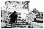 Black-and-white photo of DACA information table.