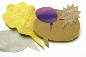 Word bubbles made of paper materials.