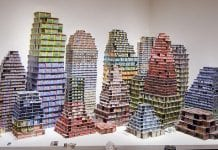 Buildings composed of lottery tickets.