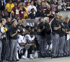 Football players kneel during national anthem.