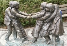 Statue of children playing tug of war.