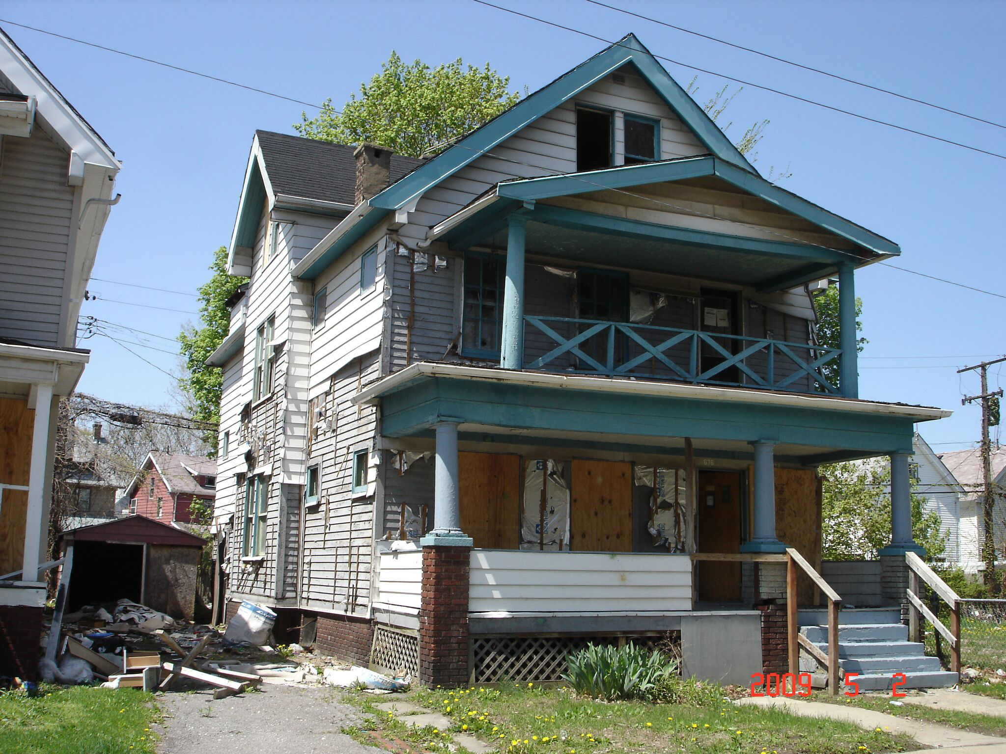 An abandoned home in Cleveland where the question lies: Should this home face demolition or renovation?