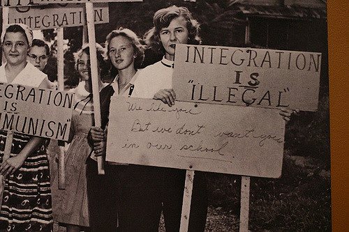 1950's young women holding anti-integration signs