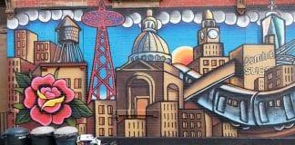 NYC skyline painted on brick wall.