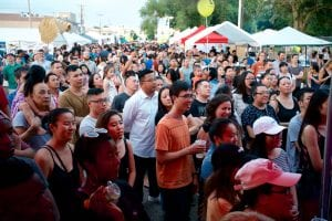 A crowd of people gather a Little Mekong Night Market in St. Paul. This is an example of food-oriented development.
