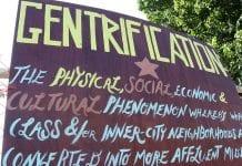 "sign defining ""gentrification"""