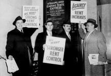 Men in topcoats and hats with rent increase protest signs.