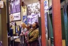 Women looking at museum exhibit