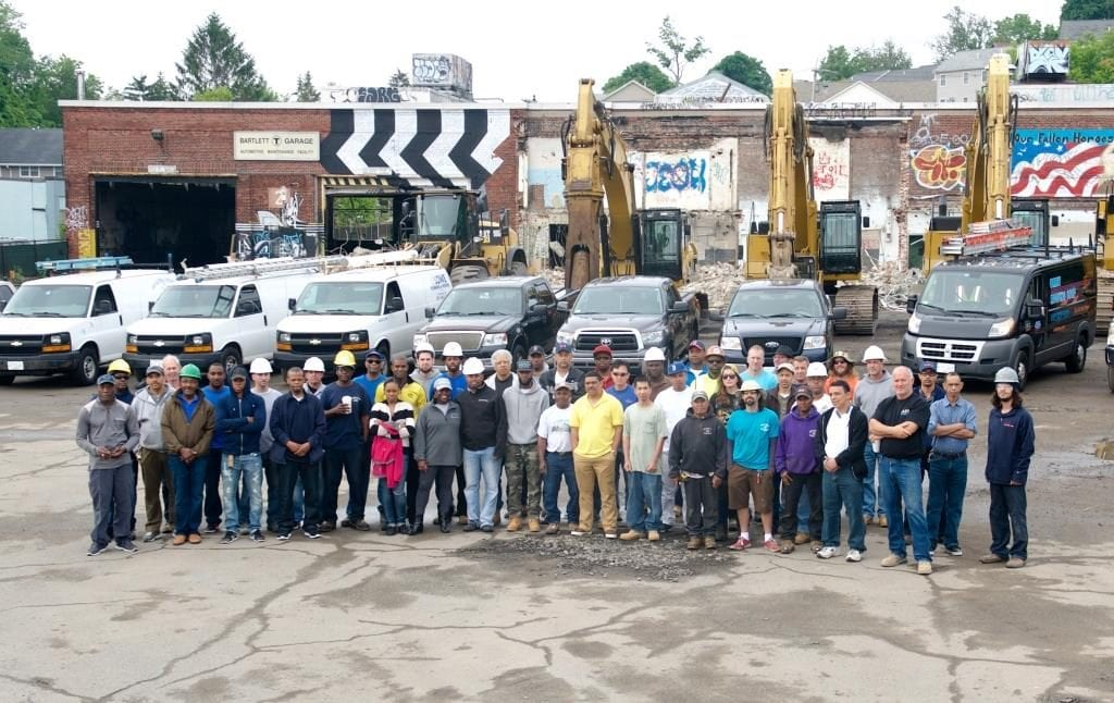Contractors stand outside of the Bartlett Station development.