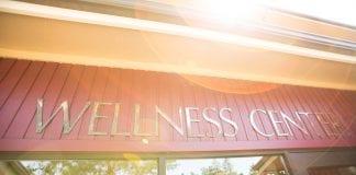 """A sign that reads """"wellness center."""""""